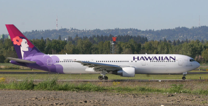 Hawaiian Airlines jet taxiing on runway
