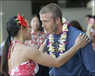 Soccer star David Beckham receives a lei from a woman in Hawaii