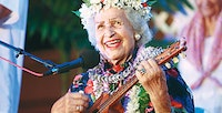 Hawaiian Musician Genoa Keawe Playing Ukulele And Wearing Lei