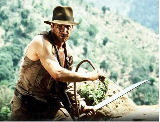Indiana Jones wearing a hat and holding a whip
