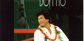 Singer Don Ho smiles on the cover of an album