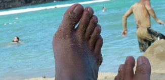 Feet up and relaxing at the beach