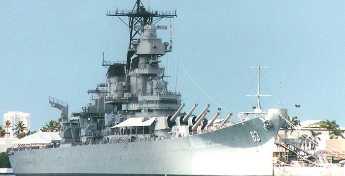 The Naval battle ship the USS Missouri shown anchored in the water in Pearl Harbor