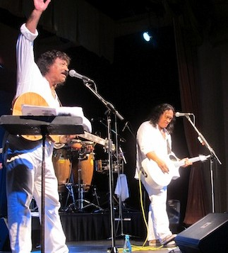 Cecilio and Kapono performing on stage