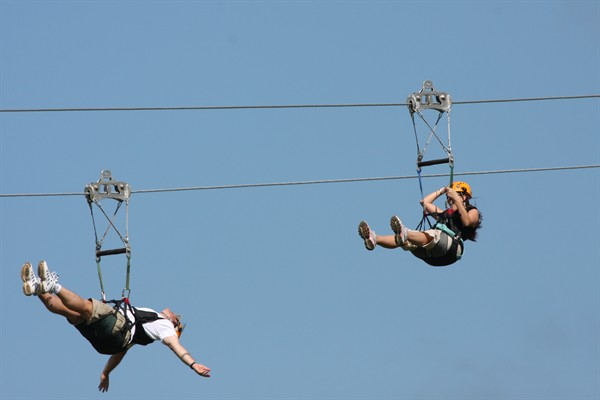 2 people on a zipline