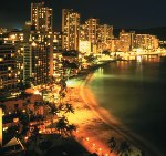 Waikiki Beach and hotels lit up at night