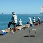 People fishing at Heeia Pier in Kaneohe