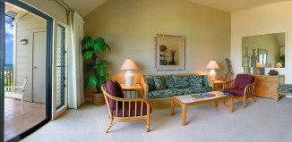A couch and chairs in the living area