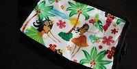 A small cloth bag with a hawaiian print