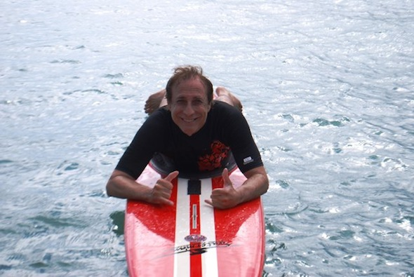 Bruce Fisher on a surfboard