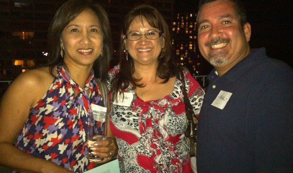 3 Hawaii Aloha Travel agents enjoying themselves at a party