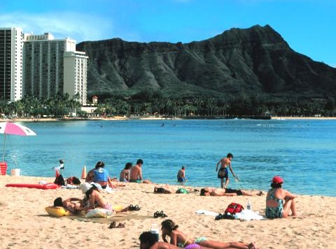Sunbathers on the sand at Ala Moana Beach Park