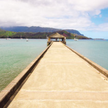 A dock extends out to the sea on Kauai