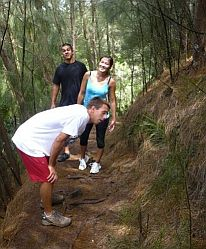 Hikers taking a break after climbing to the top of Kuliouou trail