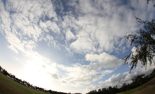 A fisheye image of clouds from a park