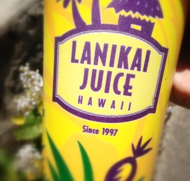 A small cup with Lanikai Juice logo