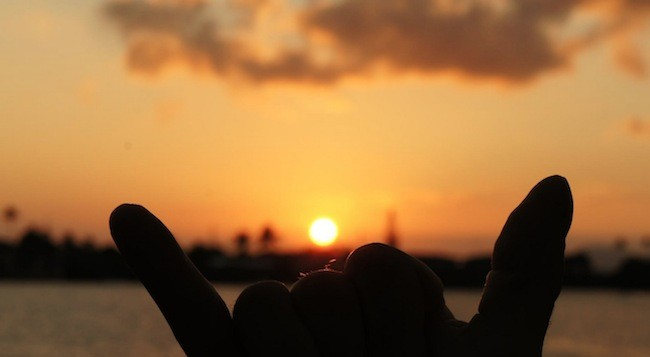 A sunset with a shaka in sillhouete