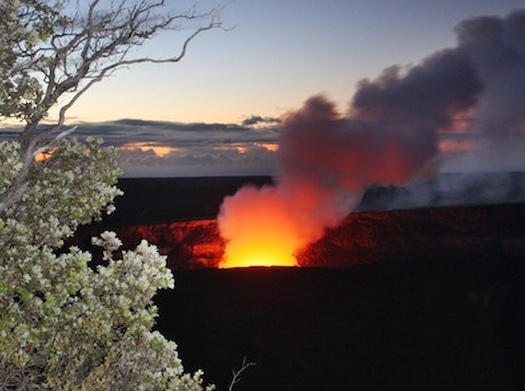 Smoke and light rises from Halemaumau Crater