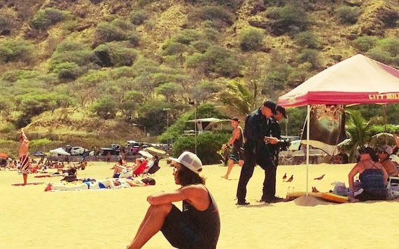 2 Policemen talking to people on the beach