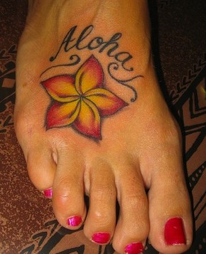 A foot with a flower tatoo on top