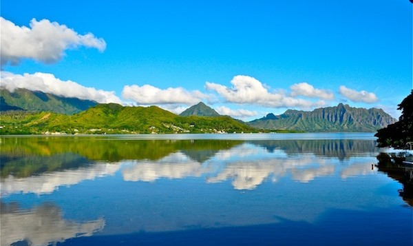 A wide shot of Kaneohe Bay with water like glass