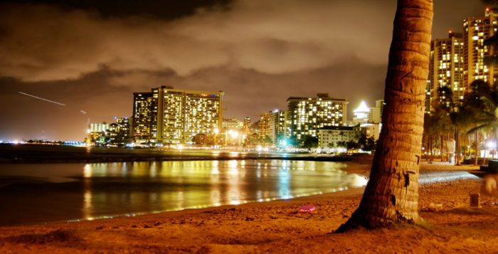 waikiki skyline at night when you arrive in honolulu