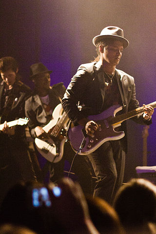 Bruno Mars performing on stage