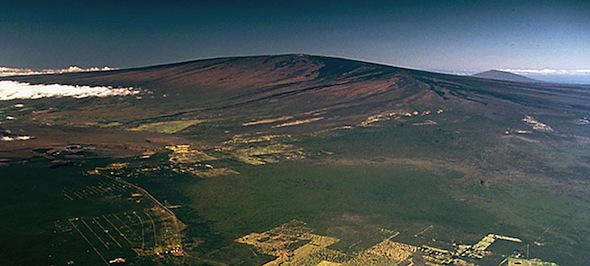 A wide aerial shot of Mauna Loa mountain from Hilo