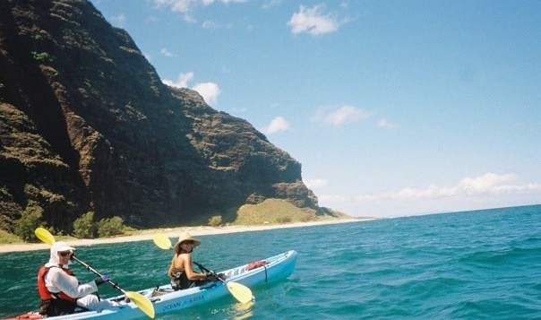 A couple kayaks on Kauai's Na Pali coast