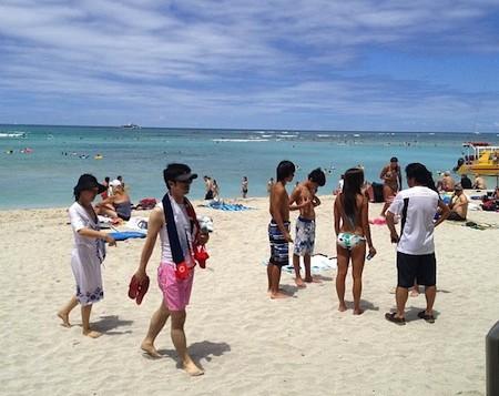 Beach goers on Wakiki beach