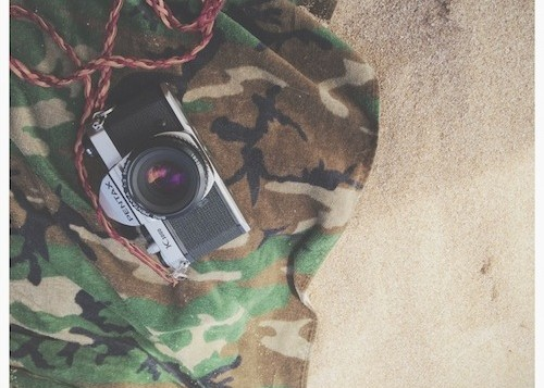Film camera on a towel at the beach