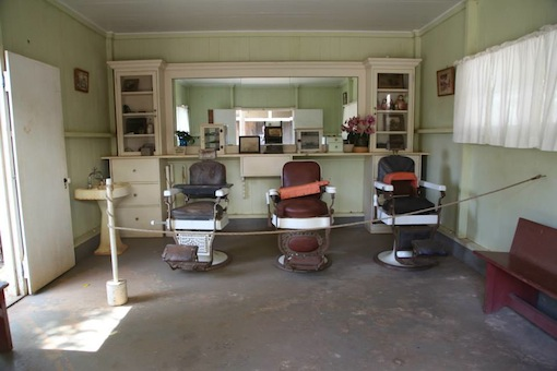 Three historic dentist chairs on display at the Hawaii Plantation Village