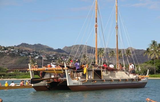 Hawaiian voyaging canoe the Hokulea sailing through a Honolulu bay