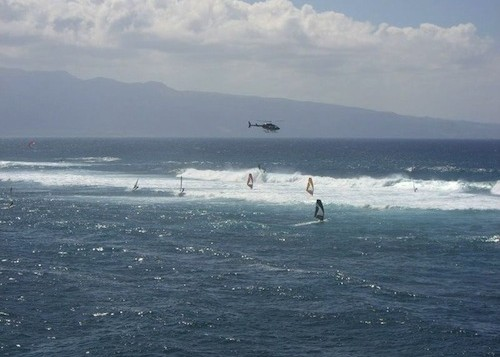 Windsurfers enjoying windy surf at Maui's Hookipa Beach