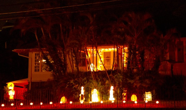 A house in Manoa with Halloween decorations lit up at night
