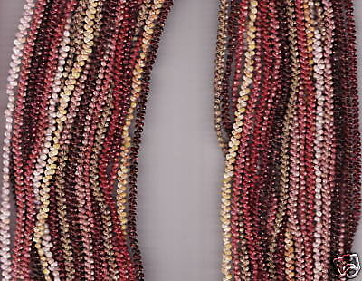 Multi-strand Niihau shell lei on display