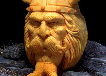 A pumpkin carved into the face of an old man