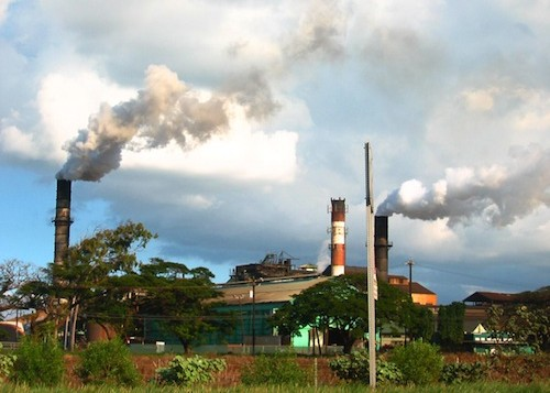 Sugar mills puffing smoke at Puunene on Maui