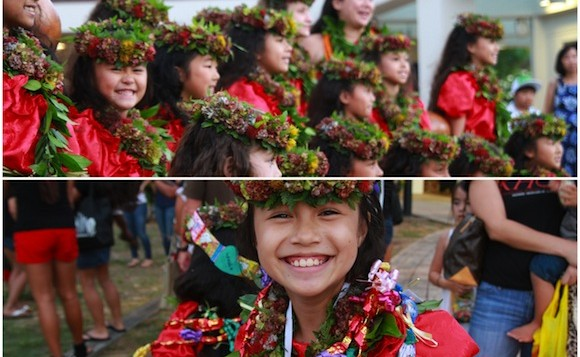 Children dressed with lei, hula skirts