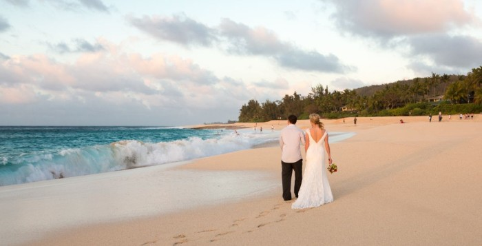 Wedding couple waking on the beach on the North shore of Oahu