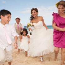 Family enjoying Hawaii wedding on the beach