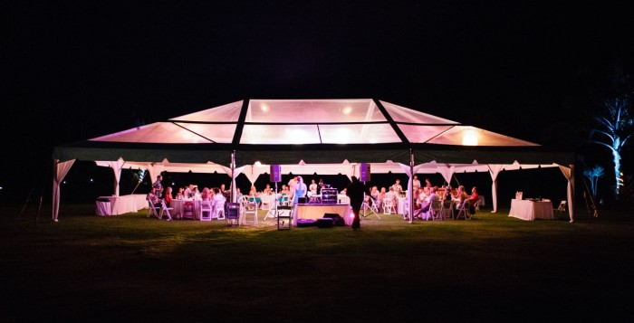 tent over outdoor wedding in Hawaii at night