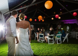 wedding couple facing reception at outdoor evening wedding