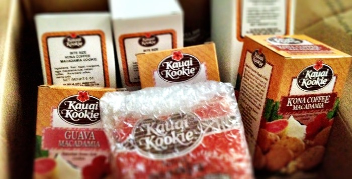 Seven boxes of Kauai Kookies in large cardboard shipping box