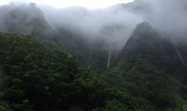 Waterfalls and low-lying clouds in Koolau Mountain range