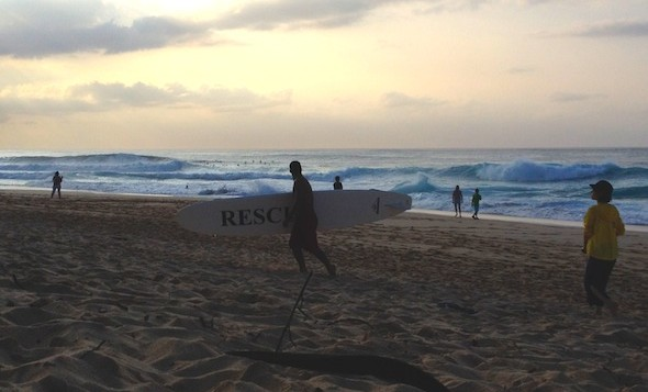 Lifeguard carries rescue board to tower on Oahu's north shore