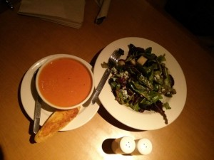 A bowl of soup with salad