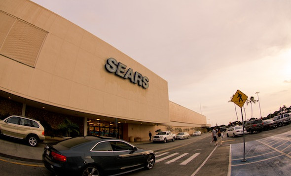 Car drives by the outside of Sears at Ala Moana Shopping Center