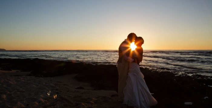 Wedding couple during sunset on the Bog island of Hawaii