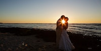 Wedding couple during sunset on the Big island of Hawaii